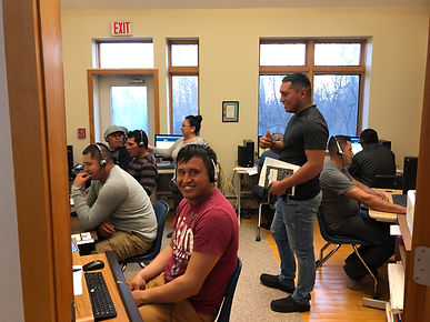 ESOL students enjoy computer lab at WLIEC with instructor Malvy Rivera (in background)