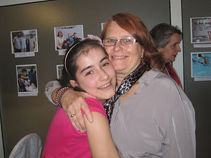 Project Life Director Linda Redfield Shakoor reunites with orphan during the American-Caucasus Conference, with volunteer Mirjam (in background), May 2013