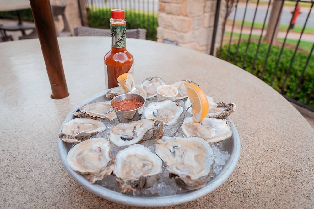 raw oysters seafood lemon cocktail hot sauce horseradish