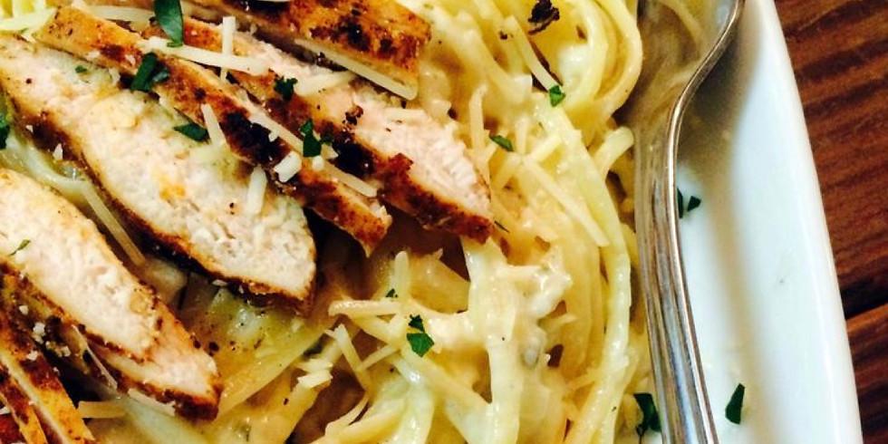 Blackened Chicken Alfredo penne pasta bake, garden salad, cheesy garlic bread