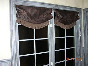 RELAXED ROMAN SHADES WITH FRINGE ALONG BOTTOM