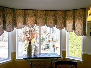 SHAPED VALANCE WITH HORNS (SHOWN ON A BAY WINDOW & WITH PIPING AT TOP)