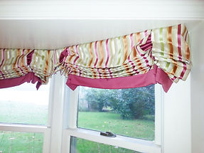 RELAXED ROMAN SHADE WITH CONTRASTING FABRIC FOR BANDING AND INSIDE PLEATS