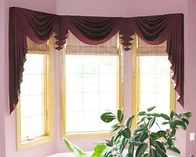 BOARD MOUNTED SWAGS WIH SIDE & CORNER JABOTS (SHOWN WITH FLAT ROMAN SHADES)