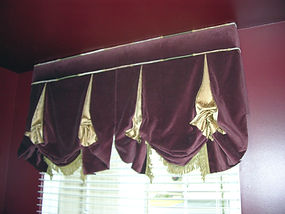 LODON ROMAN SHADE ATTACHED TO SMALL CORNICE WITH TRIMS