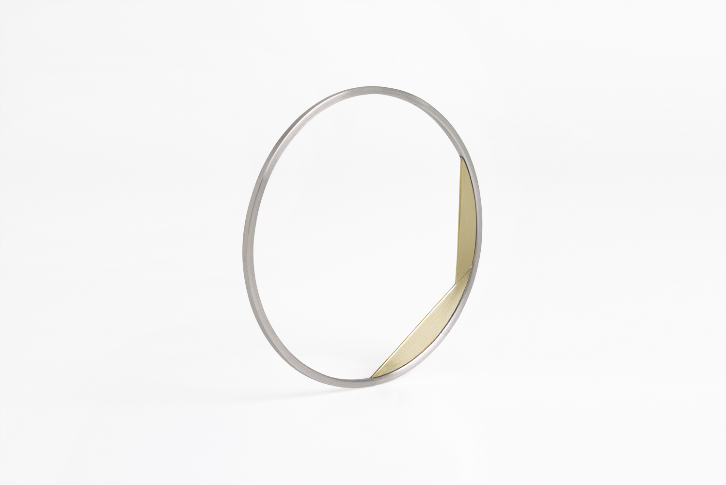 silver and brass contemporary bracel