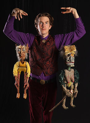 Puppeteer Dalrymple MacAlpin with marionettes Rumpelstilzchen and Dortchen