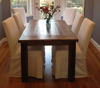 reclaimed wood dining table with breadbo