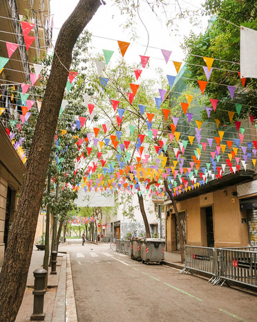 Colorful flags in a cute street in barcelona spain