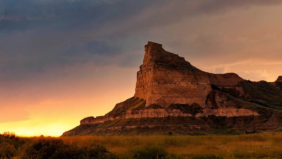 A landscape photo of the Scotts Bluff National Monument during sunset in Scottsbluff, Nebraska.