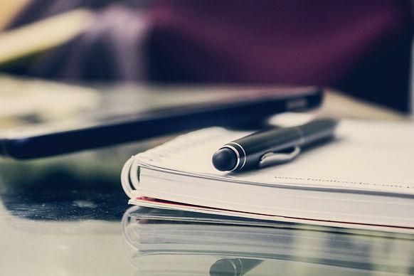 black-twist-pen-on-notebook-891059.jpg