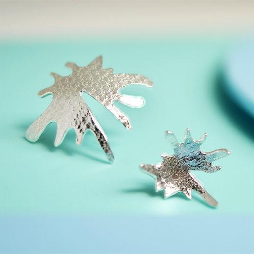 Asymmetric splash silver stud earrings