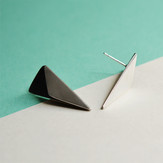 Fold-formed geometric silver earrings with an oxidised interior