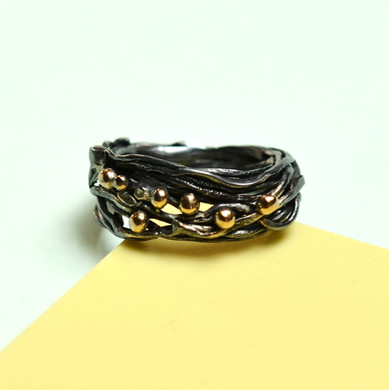 Wrap around oxidised silver ring with gold granulation