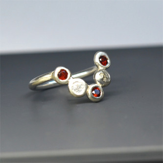 geometric silver ring with rubies