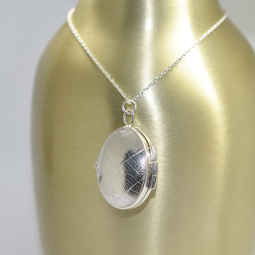 Handmade two page oval locket