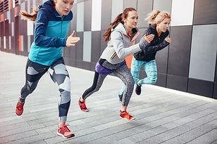 Athetic Women Sprinting