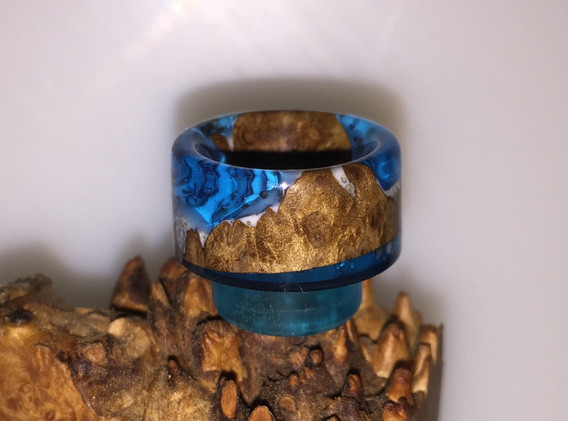 Blue resin with white coated stab wood