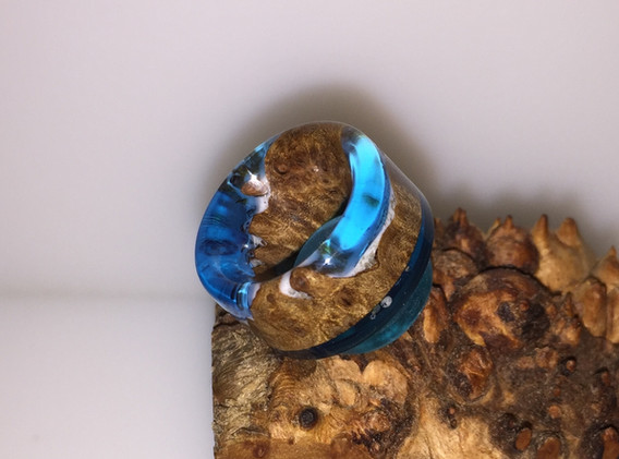 Blue resin with white coated stab wood.J