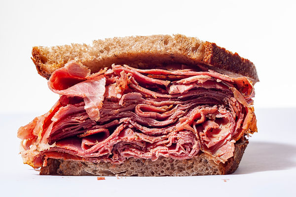 Large pastrami sandwich piled high with