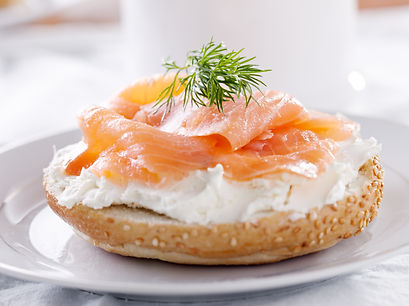 Salmon lox with cream cheese on bagel