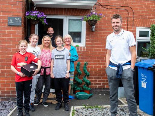 Doorstep deliveries: Michael Carrick drops off 'back-to-school' packs for local youngsters