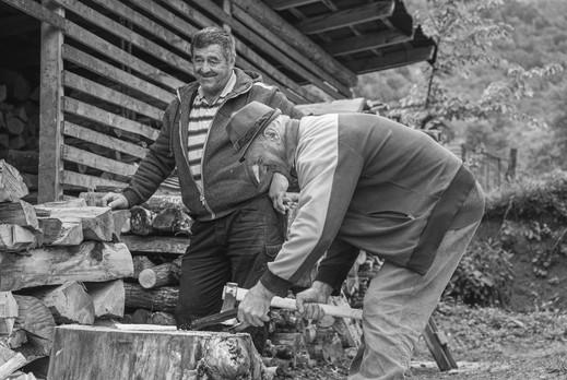 old men cutting wood.jpg