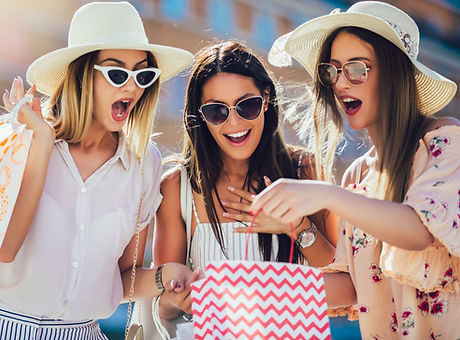 Three beautiful girls in sunglasses with