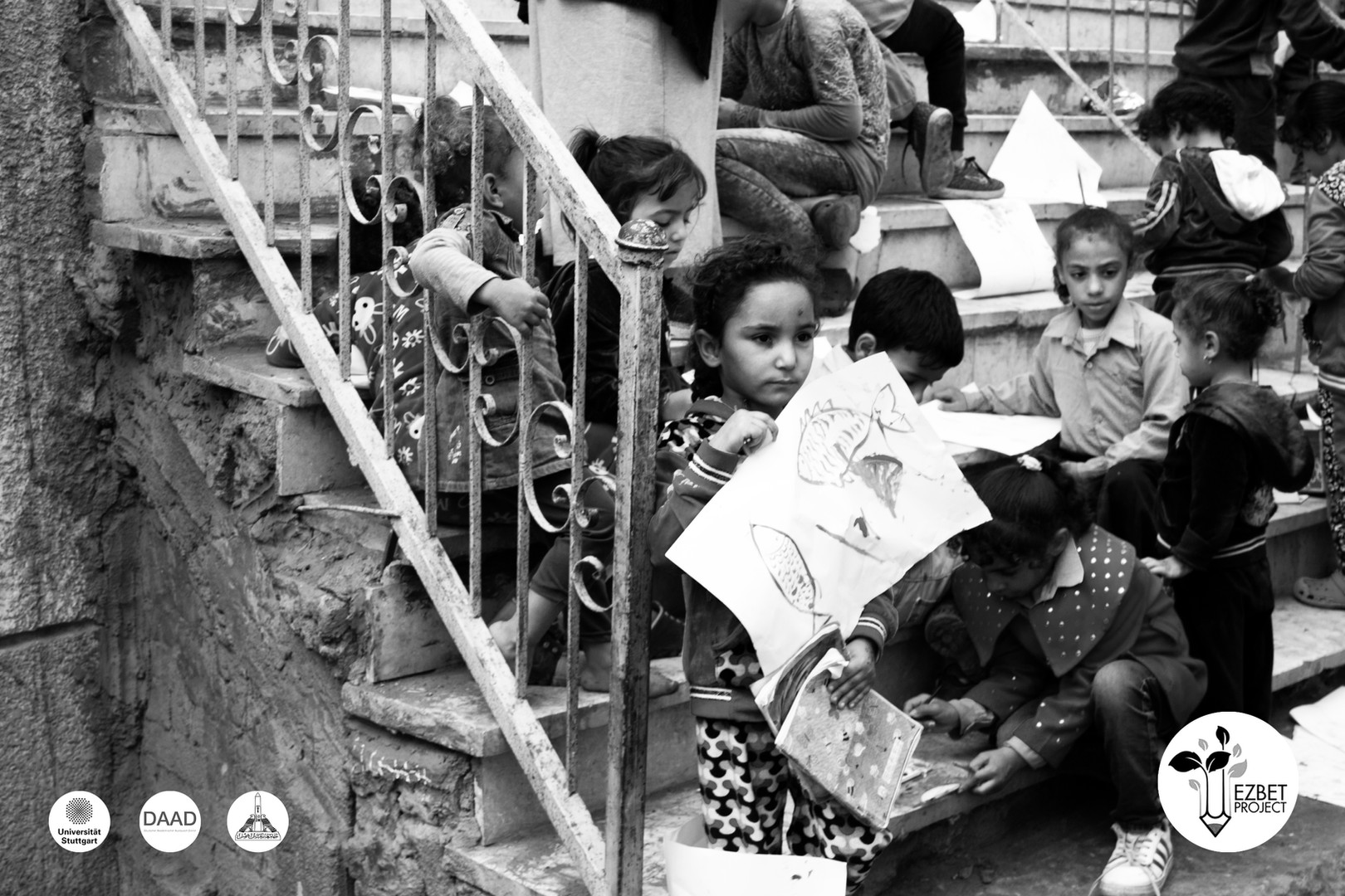 Geziret Al Dahab 1 - Kids on Staircase holding their drawings