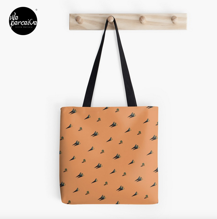 Orange stylish tote bag with pyramid illustration pattern