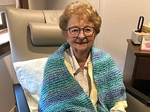 Picture of a dear recipient of one of the handmade, knitted prayer shawls.