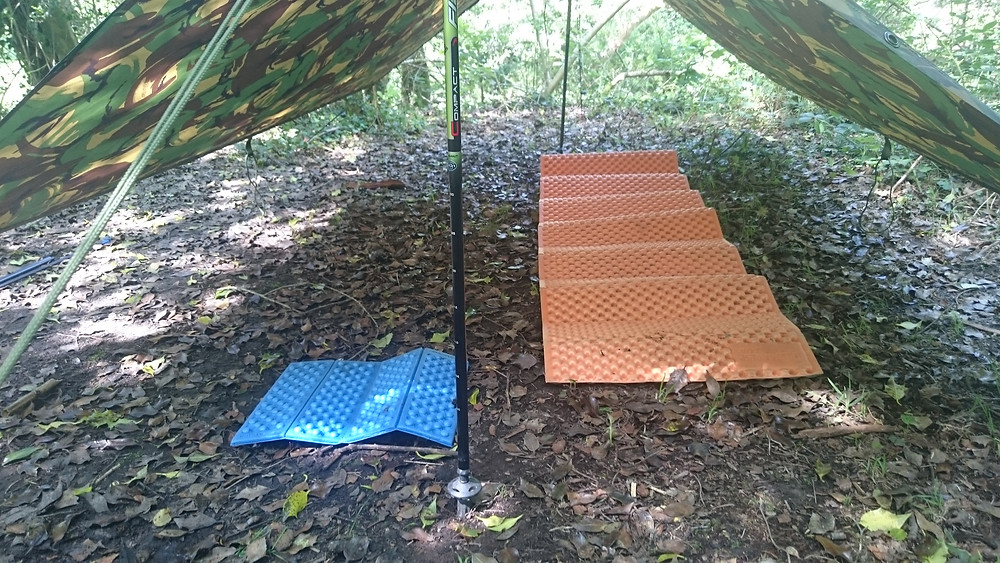 Basha set up with sleep mats, wild camping. Adventure Accessories
