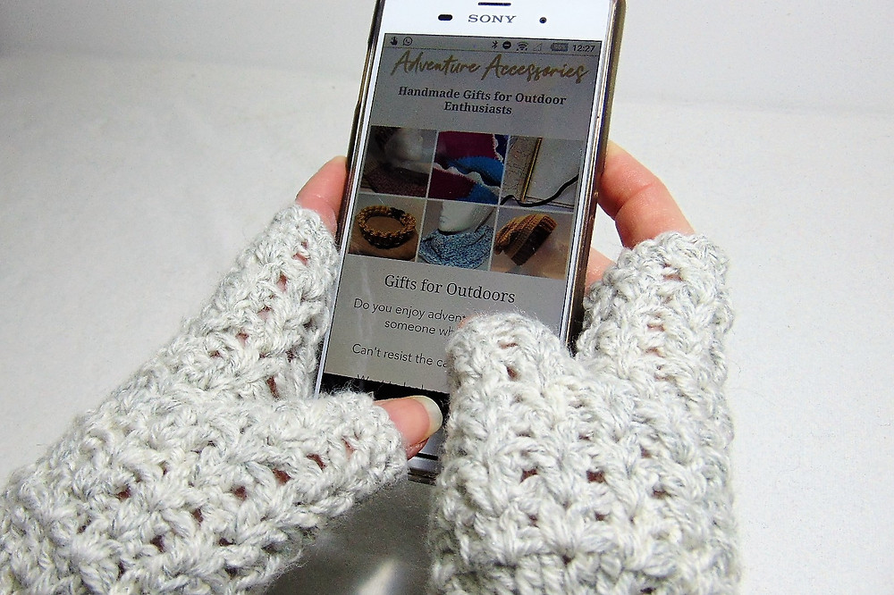 Hiking Mitts using mobile phone. Adventure Accessories