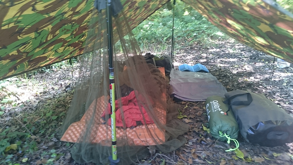 Basha set up with mosquito net protection, wild camping. Adventure Accessories