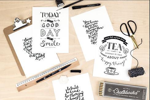 Hand lettered prints flat lay.jpg