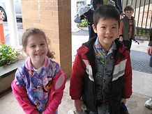 students outside of the school building.