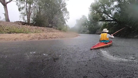 Pete in a downpour, Ovens River, Stage 8, upstream of Myrtleford