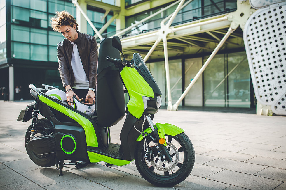 Man putting helmet in boot of his S01 Silence electric scooter