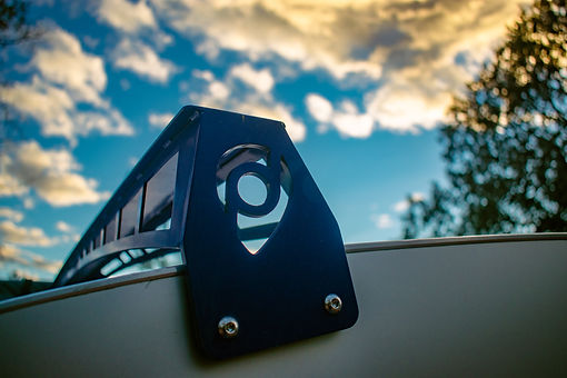 Pindrop teardrop travel trailer roof rack with blue sky in the background