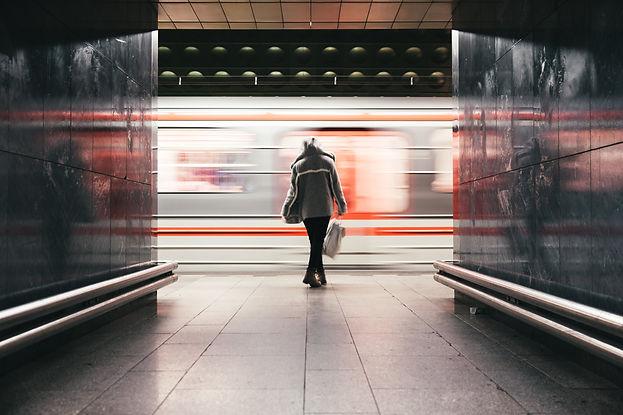 woman-waits-train-speeds-by.jpg