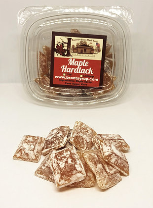 A stack of sweet maple hard tack candy sitting in front of 4 ounce Brantview Farms Maple hard tack package