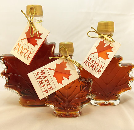 Three glass maple leaf shape containers filled with 100% pure, single source maple syrup produced at Brantview Farms Maple