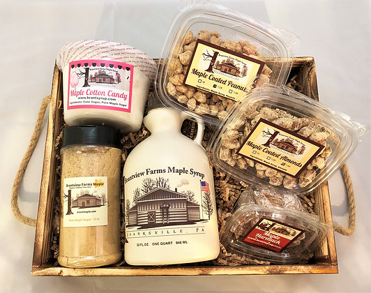 A large wood crate with a variety of Brantview Farms Maple products including 100% pure maple syrup, sugar, nuts and candy.