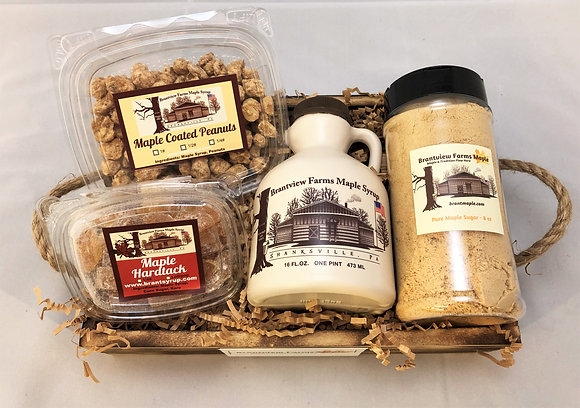 A small brown basket with a variety of Brantview Farms Maple products including 100% pure maple syrup, sugar, nuts and candy.