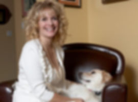 Homeopath and Social Worker Judith with her therapy dog.
