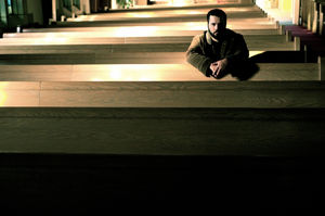 man sitting in church
