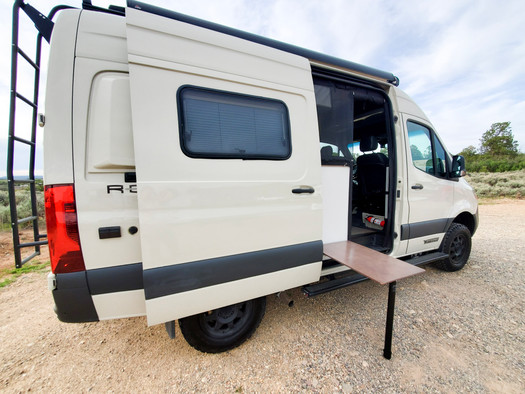 Revel 4x4 Sprinter Van Rental - Outside Table