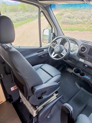 Revel 4x4 Sprinter Van Rental - Driver's Seat