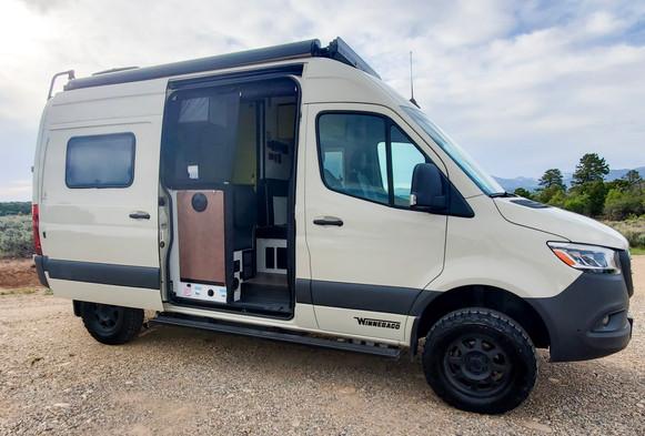 Revel 4x4 Sprinter Van Rental - Open Door