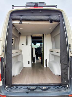 Revel 4x4 Sprinter Van Rental - Back Area With Bed
